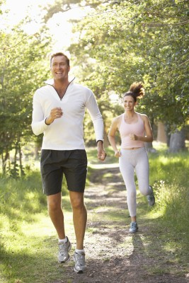 middle aged couple jogging